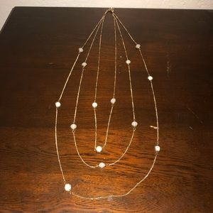 layered gold and beaded necklace